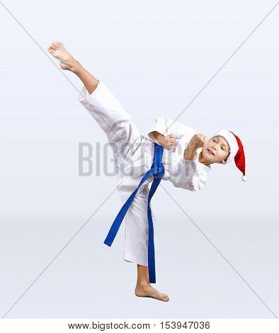 Karateka beats kick in the hat of Santa Claus