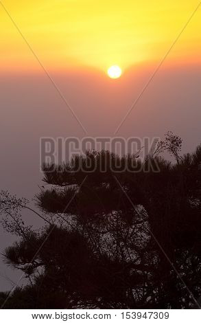 Sun rising over the Taishan Mountain range in Shandong province China.