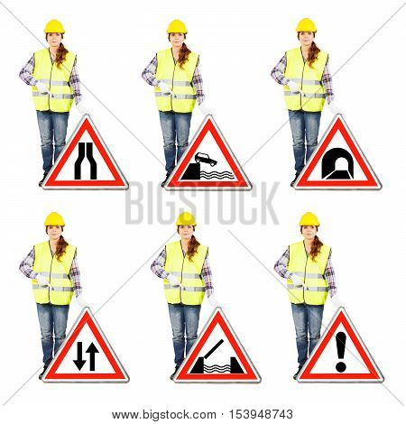Attractive Woman In Construction Helmet And Uniform With Road Signs
