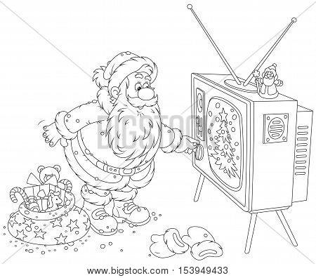 Santa Claus turning on his old wood TV set