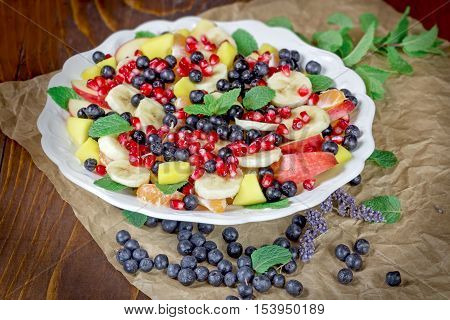 Fruit salad - delicious fruit salad with various fresh fruit as a healthy vegetarian meal