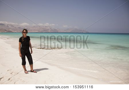 young woman on the beach of Socotra Yemen