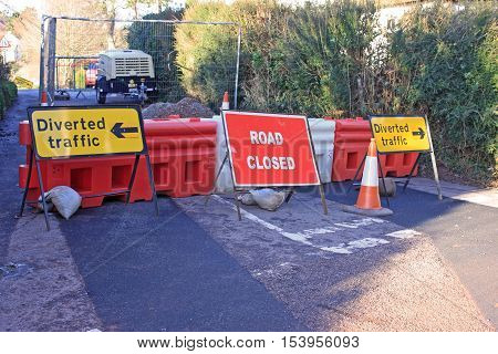 Closed road with diversion sign at roadworks