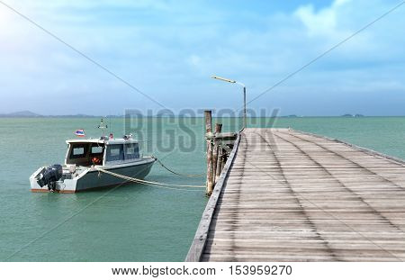 The Long Wooden Bridge And The Motor Boat