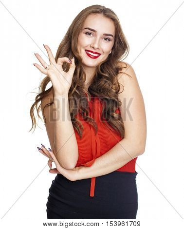 Portrait of a beautiful young brunette woman showing okey, isolated on white background