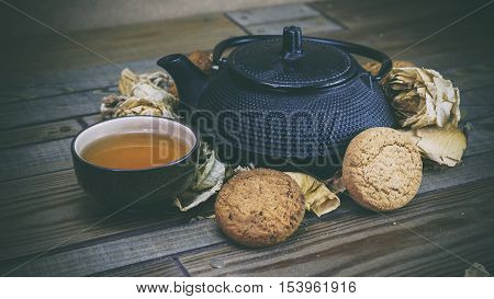 Iron Kettle On The Wooden Floor, Black Tea, Cookies And Roses