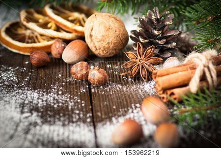 Christmas baking background. Christmas spices and nuts ingredients for cooking.