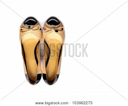 Yellow-black female shoes on a white background