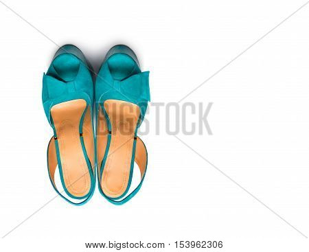 Green female shoes on a white background