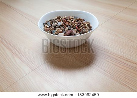 Plate full of gravel and sand on a table