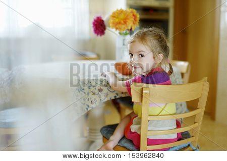 Little Girl Eating Porrige