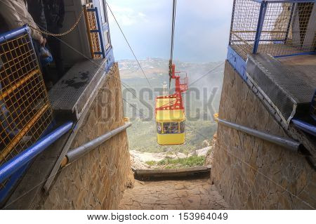 CRIMEA UKRAINE - May 04.2010: Booth of ropeway arrives on the station on the top of mountain Ai-Petri