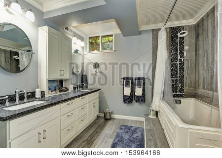 Basement Bathroom Interior In Gray And White Tones