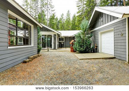 Exterior Of Suburban Home In The Wood