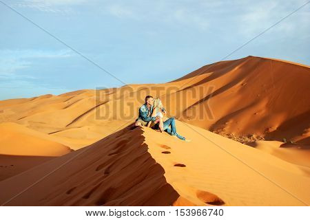 Loving couple in the Sahara Desert. Morocco.