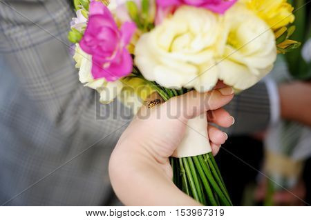 A Bee Sitting On Bride's Hand