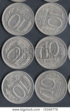 Coins on a dark textured  background
