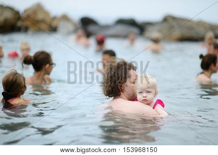 Father And His Kid Relaxing In Hot Spring