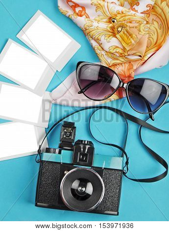The camera and slides on the table with glasses woman background flat lay travel photo. slides mockup