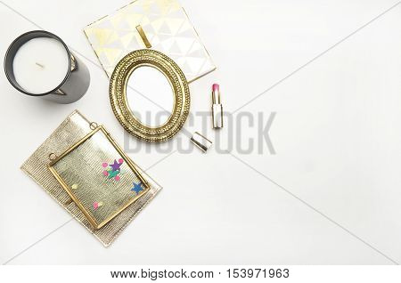 Flat lay. Mock-up product view table gold accessories. glamour style. Gold frame with candle and gold notebook. Confetti. Header website or Hero website. Workspace. Home office