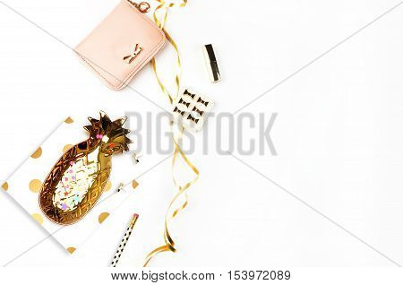 Gold items on the table top view. Background mockup. Flat lay
