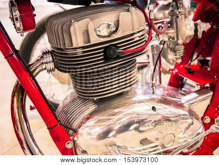 Verona Italy - May 9 2015: Detail of the head of the engine of a red vintage motorcycles.