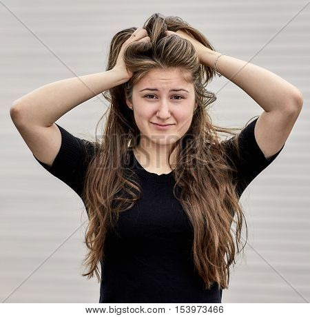 Worried Young Woman With Long Hair