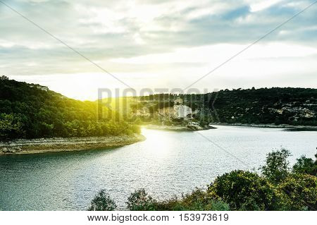 Lake island located in IsiliSardinia italian region - Wonderful panoramic view of mediterranean hinterland of Italy at sunset - Landscape and vacation concept - Vintage warm filter