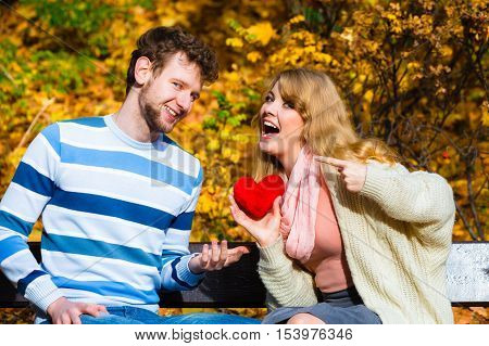 Girl Show Feelings To Man In Autumnal Park.