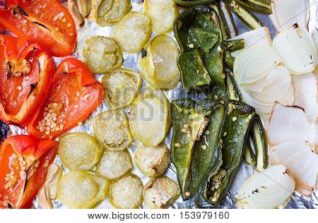 Top view of a variety of roasted vegetables from the oven