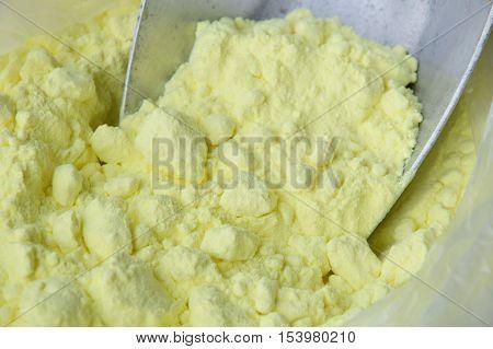 sulfur on iron scoop in plastic bag