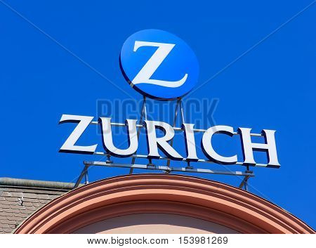 Basel, Switzerland - 27 August, 2016: Zurich Insurance Group promotion on the top of a building. Zurich Insurance Group is the largest Swiss insurance company, headquartered in Zurich.