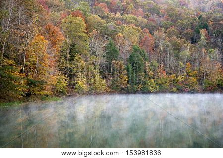 Fog lifts from the water on Cranks Creek Lake near Cranks Kentucky.