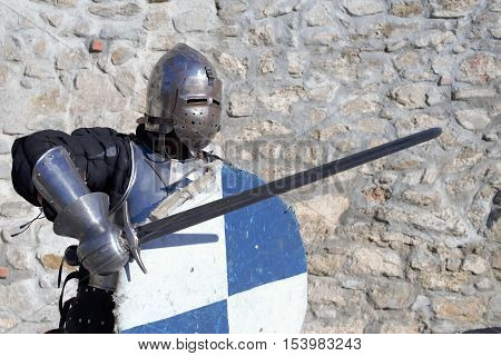 medieval metal armor and helmet mercenary knight swordsman poster
