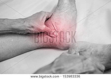 senior man hand holding he healthy foot and massaging ankle in pain area