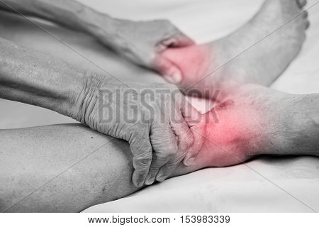 senior man hand holding he healthy foot and massaging ankle in pain area.