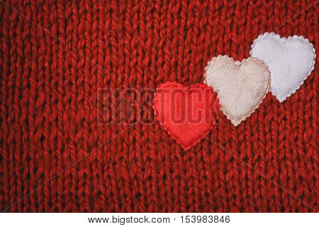 valentines day red knitted background three silk heart sewn