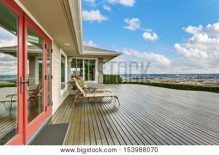 Luxury House Exterior With Large Wooden Walkout Deck