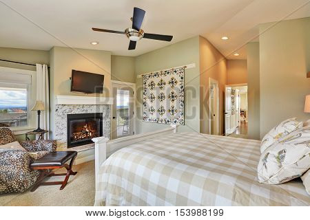 Master Bedroom Interior With Fireplace And Light Olive Walls.