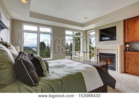 Master Bedroom Interior With Iron Bed And Fireplace