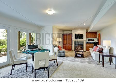 Entertainment Room With Poker Table And Cozy Family Area