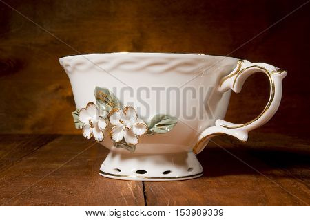 Antique teacup on a dark wooden background