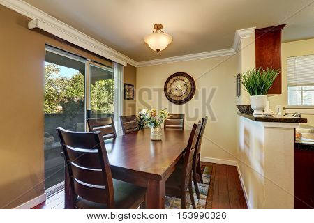 Dining area with nice wooden table set and fresh flowers. Northwest USA