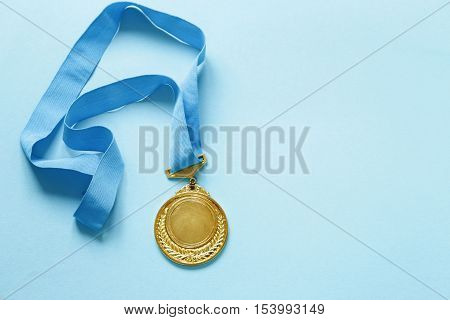 Gold medal with ribbon. The victory and the first place.