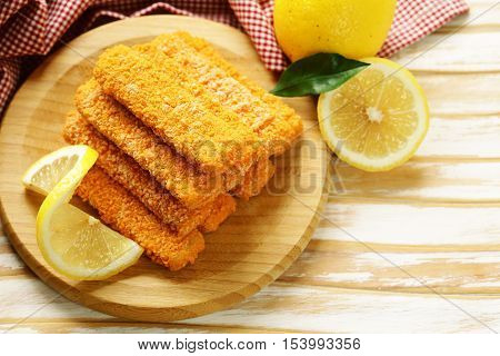 Fish fingers , breaded with fresh lemon