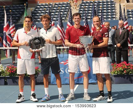 NEW YORK - SEPTEMBER 10, 2016: Guillermo Garcia-Lopez ESP (L) ,Pablo Carreno Busta ESP, Jamie Murray GBR and  Bruno Soares BRA during trophy presentation after US Open 2016 men doubles final