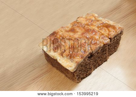 Toffee Cake Slice on wooden plate isolate