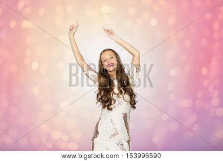 people, style, holidays and fashion concept - happy young woman or teen girl in fancy dress with sequins and long wavy hair dancing at party over rose quartz and serenity lights background