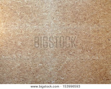 construction and building materials concept - particleboard wooden surface or board