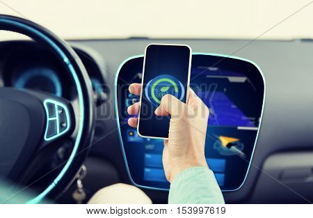 transport, business trip, technology and people concept - close up of man driving car and setting eco mode on smartphone and and navigator on board computer